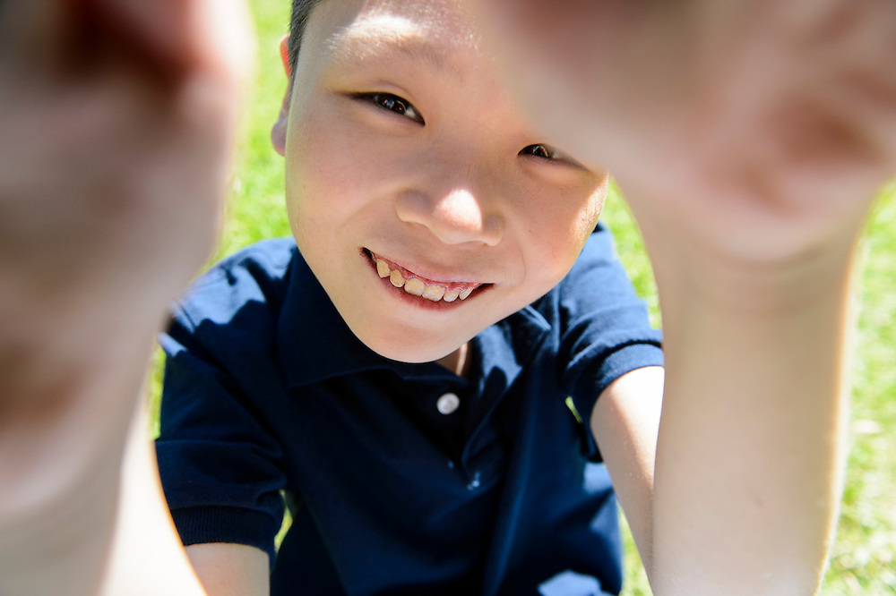 Leo, a 12-year-old orphan child from China, is pictured in Cottage Grove, Wis., during summer on June 17, 2016. Courtney and Donnie Henry are hosting the boy for a month as they advocate and strive to connect Leo with a forever family in the U.S. to adopt him. (Photo by Jeff Miller, www.jeffmillerphotography.com)