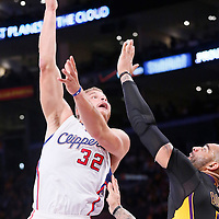 31 October 2014: Los Angeles Clippers forward Blake Griffin (32) goes for the sky hook over Los Angeles Lakers forward Carlos Boozer (5) during the Los Angeles Clippers 118-111 victory over the Los Angeles Lakers, at the Staples Center, Los Angeles, California, USA.