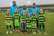 The FGR Ambassadors with Forest Green Rovers Manny Monthe(3), Forest Green Rovers Drissa Traoré(4) and Forest Green Rovers Keanu Marsh-Brown(7) during the Vanarama National League match between Forest Green Rovers and Boreham Wood at the New Lawn, Forest Green, United Kingdom on 11 February 2017. Photo by Shane Healey.