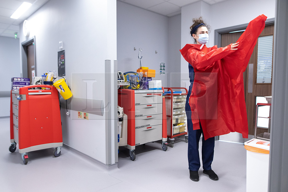 """© Licensed to London News Pictures . 21/05/2020 . Manchester , UK . Staff Nurse ANYA MATTOCKS dons PPE outside one of the hospital's """" Hot Zones """" , as she prepares to enter a room to treat a patient suspected of having Covid-19 . Specialist cancer centre , The Christie Hospital , is adapting in order to ensure the safety of patients and staff . They are reporting a drop in referrals during the UK's Coronavirus lockdown and there is concern that cancers are going undiagnosed and untreated . Photo credit : Joel Goodman/LNP"""