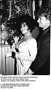 Elizabeth Taylor with her Oscar and Larry Fortensky at Swifty Lazar's last Oscar Night  Party. Spago's. Los Angeles. March 1993. Film. 93250/10<br /><br />© Copyright Photograph by Dafydd Jones<br />66 Stockwell Park Rd. London SW9 0DA<br />Tel 0171 733 0108
