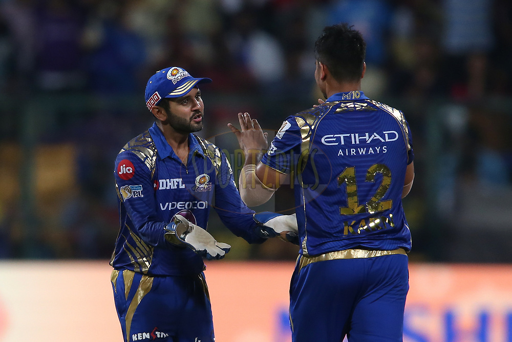 Parthiv Patel of the Mumbai Indians congratulates Karn Sharma of the Mumbai Indians for getting Ishank Jaggi of the Kolkata Knight Riders wicket during the 2nd qualifier match of the Vivo 2017 Indian Premier League between the Mumbai Indians and the Kolkata Knight Riders held at the M.Chinnaswamy Stadium in Bangalore, India on the 19th May 2017<br /> <br /> Photo by Shaun Roy - Sportzpics - IPL