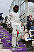 Hashim Amla of Hampshire walking out to bat during the Specsavers County Champ Div 1 match between Hampshire County Cricket Club and Worcestershire County Cricket Club at the Ageas Bowl, Southampton, United Kingdom on 13 April 2018. Picture by Graham Hunt.
