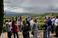 Italy, La Foce - Visitors take a guided tour of the gardens of La Foce property. The garden guide (fourth from left) is artist Sibyilla Holtz. The garden is a perfect example of italian style garden and is considered among the top 20 gardens of Italy.<br /> Ph. Roberto Salomone
