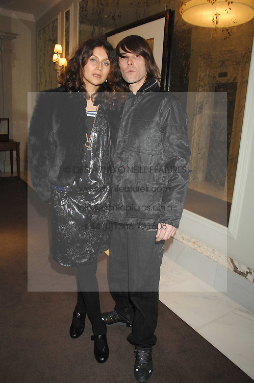 Singer IAN BROWN from the Stone Roses and his wife FABIOLA at a party to launch the Dom Perignon OEotheque 1995 held at The Landau, Portland Place, London W1 on 26th February 2008.<br />