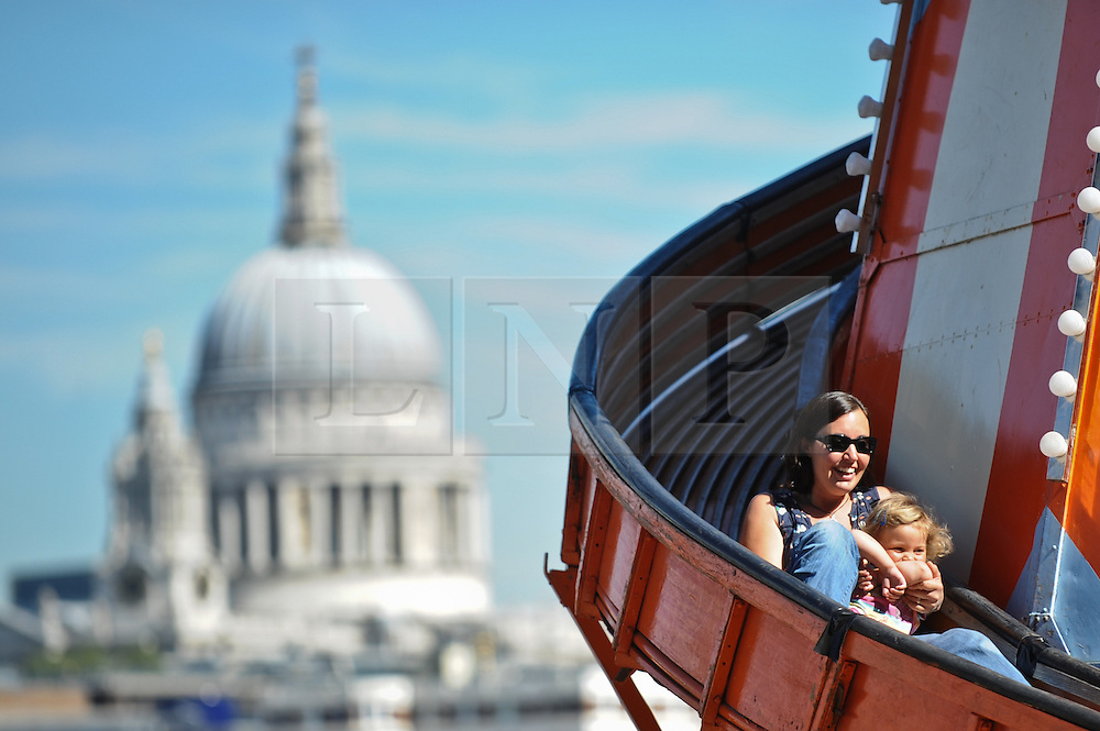 "© Licensed to London News Pictures. 08/09/2012. London,UK.People taking part at ""The Mayor's Thames Festival 2012"" from the London Eye to St Katharine docks and beyond . London's Largest free festival sees 800,000 descend on the banks of the Thamsea from 8th to 9th September.Photo credit : Thomas Campean/LNP..."
