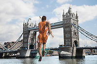 Male Athlete about to vault over Tower Bridge