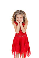Portrait of girl in red frock with head in hands over white background