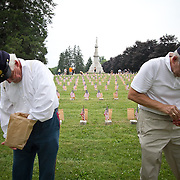 "Volunteers, John Reynolds, left and Bill Presutti, prepare luminaria at the Soldiers National Cemetery, during the Sesquicentennial Anniversary of the Battle of Gettysburg, Pennsylvania on Sunday, June 30, 2013.   Following ""A New Birth of Freedom"" program at Meade's Headquarters, a procession by candlelight was led to the cemetery. John Boal photography"