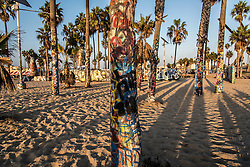 Palm trees are painted in graffiti along the boardwalk  of Venice Beach, California October 9, 2014. (Photo by Ami Vitale)