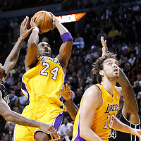 19 January 2012:  Los Angeles Lakers shooting guard Kobe Bryant (24) goes for the lay up past Miami Heat power forward Udonis Haslem (40) during the Miami Heat 98-87 victory over the Los Angeles Lakers at the AmericanAirlines Arena, Miami, Florida, USA.