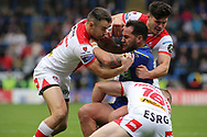 Bodene Thompson of Warrington Wolves tackled by Ryan Morgan and Luke Thompson of St Helens during the Betfred Super League Super 8s match at the Halliwell Jones Stadium, Warrington<br /> Picture by Stephen Gaunt/Focus Images Ltd +447904 833202<br /> 22/09/2018
