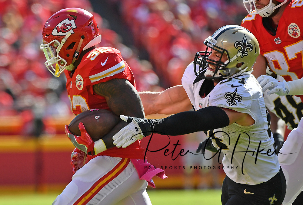 KANSAS CITY, MO - OCTOBER 23:  Linebacker Nate Stupar #54 of the New Orleans Saints reaches out to tackle running back Spencer Ware #32 of the Kansas City Chiefs during the second half on October 23, 2016 at Arrowhead Stadium in Kansas City, Missouri.  (Photo by Peter G. Aiken/Getty Images) *** Local Caption *** Nate Stupar;Spencer Ware