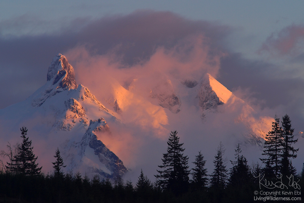 Three Fingers Mountain, located in the Central Range of Washington state, is partially obscured by a snow storm in this sunset image taken near Darrington. Three Fingers Mountain has an elevation of 6854 feet (2089 meters).