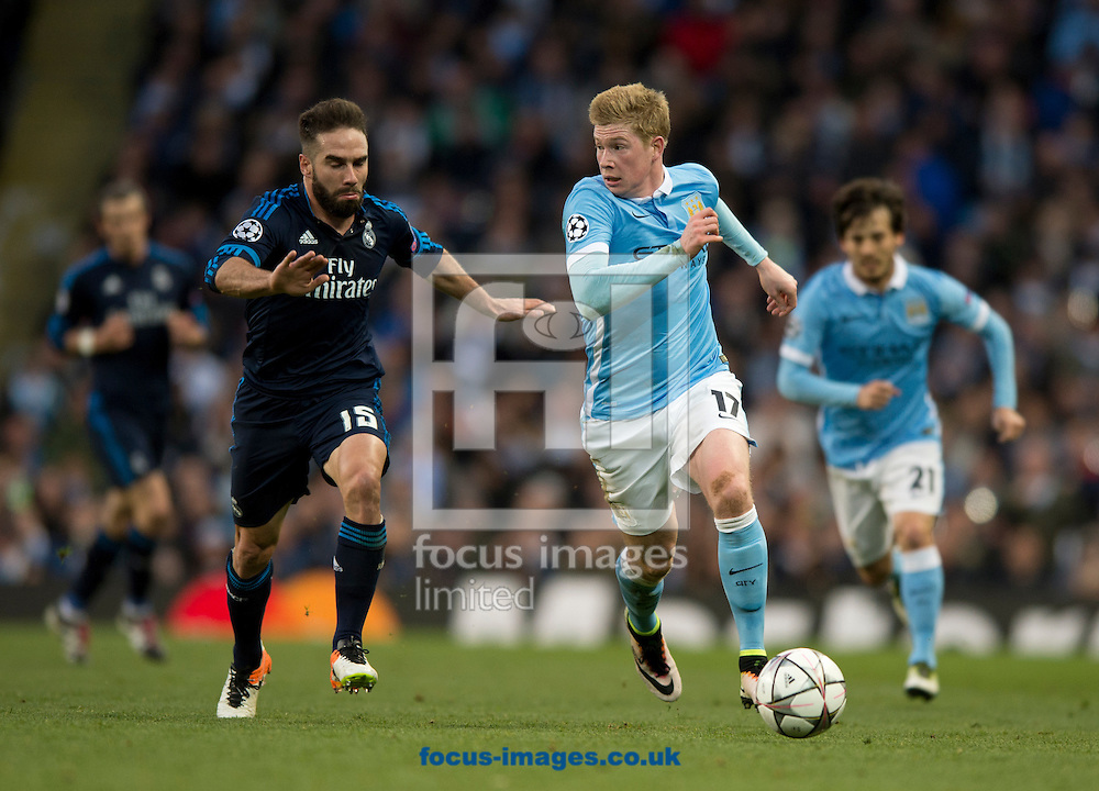 Kevin De Bruyne of Manchester City looks to pull away from Daniel Carvajal of Real Madrid during the UEFA Champions League match at the Etihad Stadium, Manchester<br /> Picture by Russell Hart/Focus Images Ltd 07791 688 420<br /> 26/04/2016