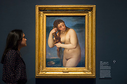 "© Licensed to London News Pictures. 28/02/2019. LONDON, UK. A staff member views ""Venus Rising from the Sea (Venus Andyomene)"" c1520 by Titian. Preview of ""The Renaissance Nude"", an exhibition at the Royal Academy of Arts in Piccadilly of 90 works examining the emergence of the nude in European art.  Works by artists including Leonardo da Vinci to Michelangelo are on display in the Sackler Galleries 3 March to 2 June 2019.  Photo credit: Stephen Chung/LNP"