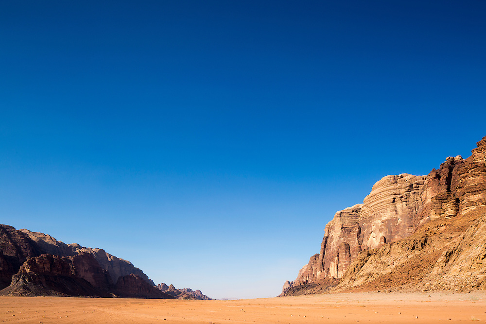 Jordan, Aqaba Governorate, Granite outcrops amid red sand desert at Wadi Rum,The Valley of the Moon