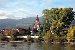 Wachau Valley, Austria:  Weissenkirchen, in the heart of the Austrian wine-growing region.  Area is thought to be the origin of the Riesling grape, and terraces of vines surround the town.  This is one of the many views seen on a Danube Cruise between Melk and Durnstein.
