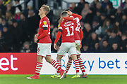 Barnsley's Conor Chaplin, Clarke Oduor and Luke Thomas celebrate after scoring during the EFL Sky Bet Championship match between Derby County and Barnsley at the Pride Park, Derby, England on 2 January 2020.