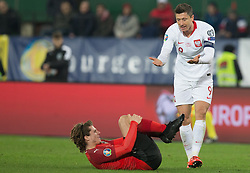 March 21, 2019 - Vienna, Austria - Marcel Sabitzer of Austra and Robert Lewandowski of Polandduring the UEFA European Qualifiers 2020 match between Austria and Poland at Ernst Happel Stadium in Vienna, Austria on March 21, 2019. (Credit Image: © Foto Olimpik/NurPhoto via ZUMA Press)