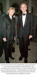 SIR NICHOLAS & LADY GOODISON, at a reception in London on 25th September 2002.	PDL 146
