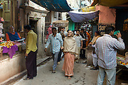 Indian people in alleyway in the holy city of Varanasi, Benares, Northern India