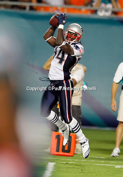 New England Patriots wide receiver Deion Branch (84) leaps and catches a pass during the NFL week 1 football game against the Miami Dolphins on Monday, September 12, 2011 in Miami Gardens, Florida. The Patriots won the game 38-24. ©Paul Anthony Spinelli