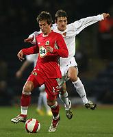 Photo: Paul Thomas.<br /> Blackburn Rovers v Basle. UEFA Cup. 02/11/2006.<br /> <br /> Morten Gamst Pedersen (L) of Blackburn runs past Zdravko Kuzanovic.