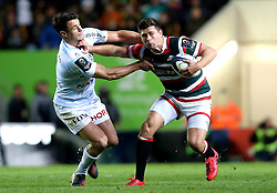 Ben Youngs of Leicester Tigers hands off Dan Carter of Racing 92 - Mandatory by-line: Robbie Stephenson/JMP - 23/10/2016 - RUGBY - Welford Road Stadium - Leicester, England - Leicester Tigers v Racing 92 - European Champions Cup