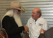 The Oak Ridge Boys William Lee Golden greets ASU head football coach Jerry Moore backstage of benefit concert in Boone NC for the Sugar Grove Developmental Day School