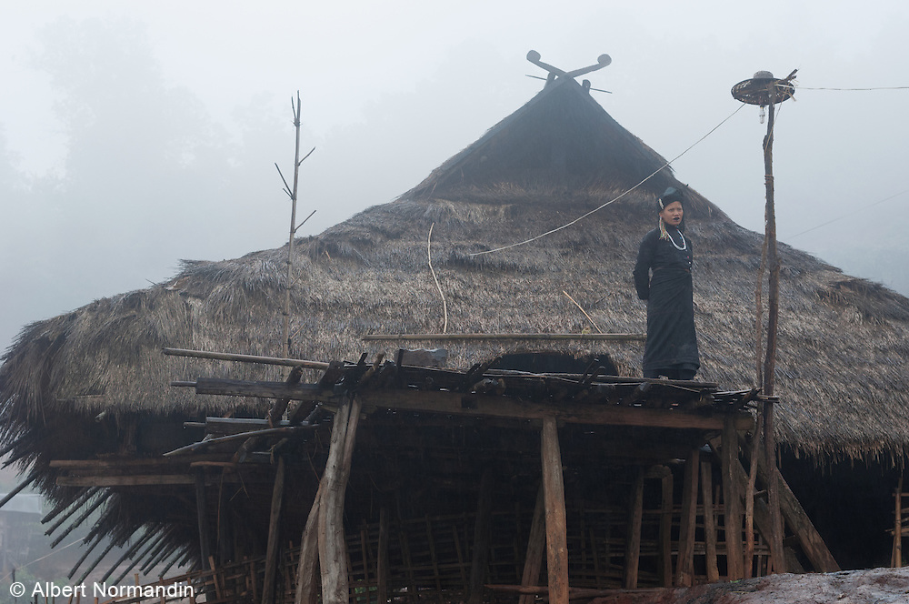 Traditional Hill tribe woman at home with straw roof