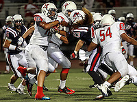 Ernesto Ruiz (43) attempts to strip the ball from Sione Takitaki (16) in a high scoring game between Great Oak and Heritage with Great Oak coming out on top, 43-40.  Game at Heritage High School.  Image Credit: Amanda Schwarzer