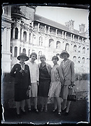 fashionable dressed women only group posing in front of a luxurious building France circa 1920s