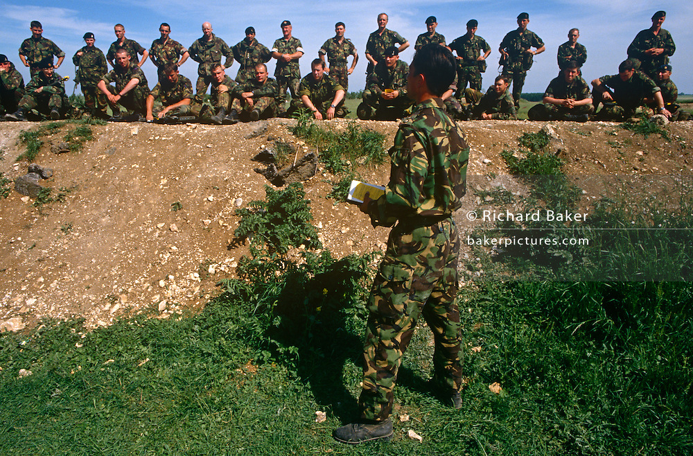 British Army Gurkha soldier instructs his men during an exercise on Salisbury Plain, the army's infantry training ground.
