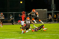 KELOWNA, BC - AUGUST 17:  Jonah Williams #34 runs in to tackle as Dawson Puk #49 jumps over Garret CAPE #2 of Okanagan Sun against the Westshore Rebels at the Apple Bowl on August 17, 2019 in Kelowna, Canada. (Photo by Marissa Baecker/Shoot the Breeze)