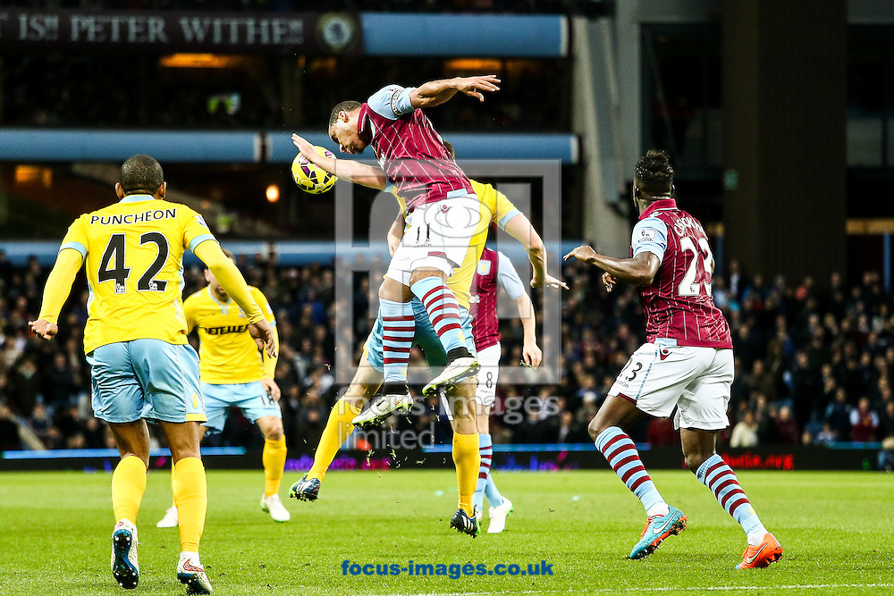 Gabriel Agbonlahor of Aston Villa (centre) heads clear in defence during the Barclays Premier League match at Villa Park, Birmingham<br /> Picture by Andy Kearns/Focus Images Ltd 0781 864 4264<br /> 01/01/2015