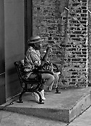 Elderly lady resting on bench in downtown Vicksburg, Mississippi