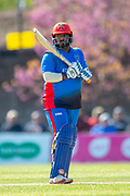 Afghan cricketer Mohammad Shahzad bats during the One Day International match between Scotland and Afghanistan at The Grange Cricket Club, Edinburgh, Scotland on 10 May 2019.
