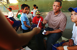 Miguel Cabrera sits in the stadium behind his childhood home where he grew up playing baseball in La Pedrera, as neighborhood in Maracay, Venezuela.  The stadium now bears a sign proclaiming it as the cradle of the community's first big leaguer.  Cabrera, who hit cleanup for the world champion Florida Marlins after being called up during the season, signed a 1.8 million dollar contract when he was 16.