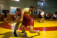 Emin Kiliç, in red, wrestles a competitor during a training session for wrestlers in one of Istanbul's oldest and most well renowned clubs. Haydarpaşa Demirspor Kulbübü, Istanbul, Turkey.