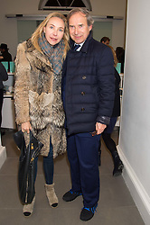 SIMON DE PURY and MICHAELA NEUMEISTER at the opening of the exhibition Champagne Life in celebration of 30 years of The Saatchi Gallery, held on 12th January 2016 at The Saatchi Gallery, Duke Of York's HQ, King's Rd, London.