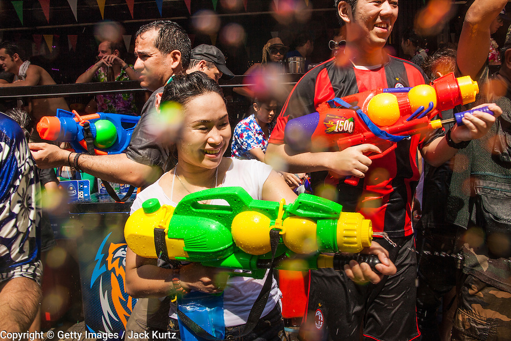 14 APRIL 2013 - BANGKOK, THAILAND:  A community water fight on Soi Nana on April 14, 2013 in Bangkok, Thailand. The Songkran festival is celebrated in Thailand as the traditional New Year's Day from 13 to 15 April. The throwing of water originated as a way to pay respect to people and is meant as a symbol of washing all of the bad away. PHOTO BY JACK KURTZ