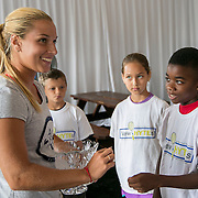 August 15, 2014, New Haven, CT:<br /> Kids from the New HYTEs youth development organization draw chips from Dominika Cibulkova during the draw ceremony at the 2014 Connecticut Open at the Yale University Tennis Center in New Haven, Connecticut Friday, August 15, 2014.<br /> (Photo by Billie Weiss/Connecticut Open)