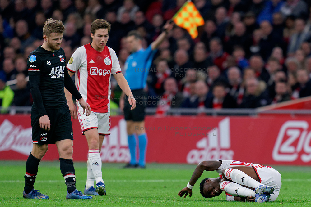 Quincy Promes #11 of Ajax, Fredrik Midtsjo #6 of AZ Alkmaar, Carel Eiting #8 of Ajax in action during the Dutch Eredivisie match round 25 between Ajax Amsterdam and AZ Alkmaar at the Johan Cruijff Arena on March 01, 2020 in Amsterdam, Netherlands