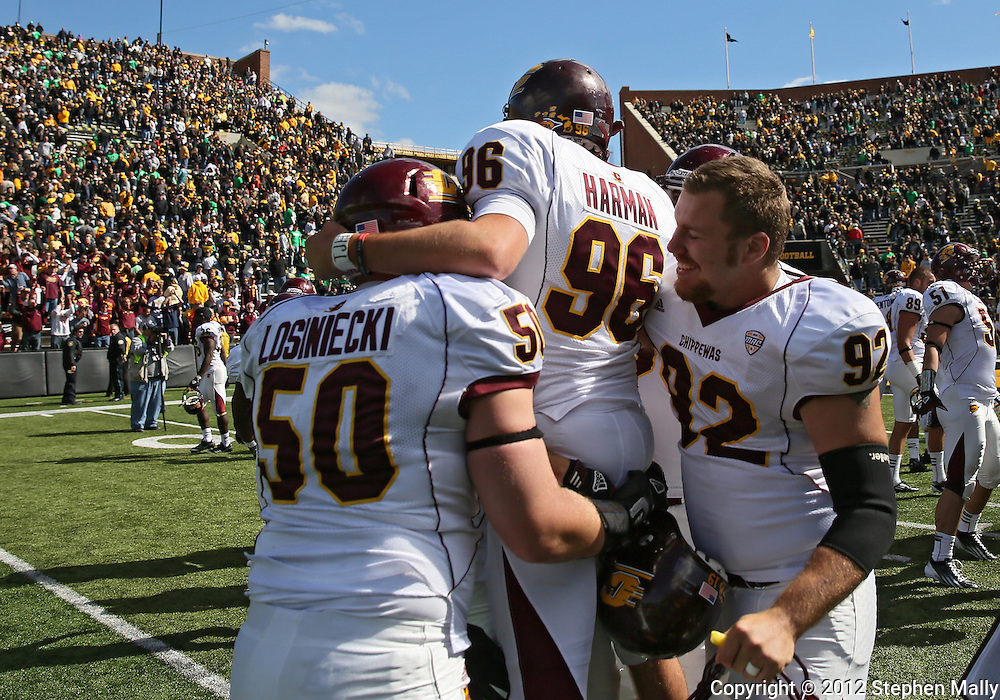 September 22 2012: Central Michigan Chippewas kicker David Harman (96) celebrates with defensive lineman Matt Losiniecki (50) and long snapper Mike Zenk (92) after the end of the NCAA football game between the Central Michigan Chippewas and the Iowa Hawkeyes at Kinnick Stadium in Iowa City, Iowa on Saturday September 22, 2012. Harman kicked the game winning 47 yard field goal. Central Michigan defeated Iowa 32-31.