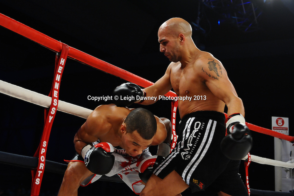 Chris Eubank Jnr against the ropes with Frankie Borg in a Middleweight contest. Glow, Bluewater, Kent, UK. Hennessy Sports © Leigh Dawney Photography 2013.