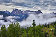 View of fog and mountain peaks in the Needles Range as viewed from Molas Pass, located along the Million Dollar Highway between the towns of Silverton and Durango, Colorado