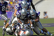Kansas State defenders Ian Campbell (98), Brandon Archer (46) and Byron Garvin (6) gang tackle Oklahoma State running back Mike Hamilton (29) in the first half at Bill Snyder Family Stadium in Manhattan, Kansas, October 7, 2006.  The Wildcats beat the Cowboys 31-27.<br />