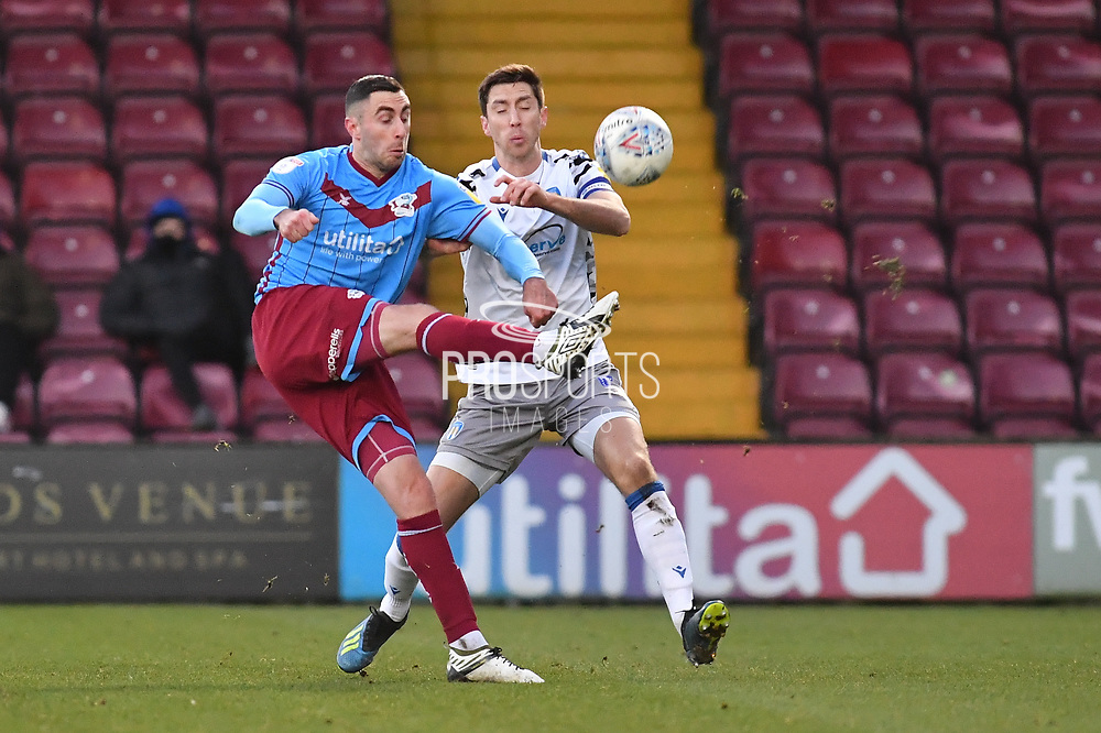 Scunthorpe United player Lee Novak (17) and Colchester United player Luke Prosser(5)  during the EFL Sky Bet League 2 match between Scunthorpe United and Colchester United at Glanford Park, Scunthorpe, England on 14 December 2019.