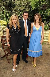Left to right, JADE JAGGER, TREVOR PICKETT and LIZ HURLEY at the Macmillan Cancer Support Dog Day held in the gardens of the Royal Hospital, Chelsea, London on 4th July 2006.<br /><br />NON EXCLUSIVE - WORLD RIGHTS